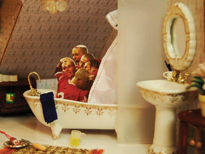 A miniature installation (using a dolls house) showing boys in a bathtub.