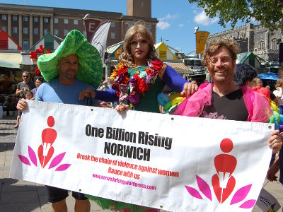 Putinca and Dugald holding a One Billion Rising banner at Norwich Markets.