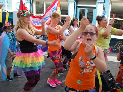 People dancing in the Norwich Pride procession.